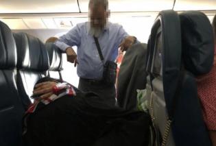 Ο άνδρας της ημέρας: Στάθηκε όρθιος για 6 ώρες στο αεροπλάνο για να κοιμηθεί η γυναίκα του & στα 2 καθίσματα (φωτό) - Κυρίως Φωτογραφία - Gallery - Video