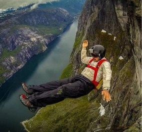 Άλαλος μένεις με τον τολμηρό άνδρα που πετάει ξυστά στα βράχια χωρίς αλεξίπτωτο  - Κυρίως Φωτογραφία - Gallery - Video