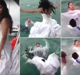 Βούτηξε στη θάλασσα και παραλίγο να την «πνίξει» το νυφικό της -Βίντεο - Κυρίως Φωτογραφία - Gallery - Video