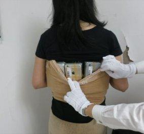 Γυναίκα - smartphone .....!!! Μετέφερε παράνομα 100 iPhones κολλώντας τα με ταινία στο σώμα της - Δείτε φωτο  - Κυρίως Φωτογραφία - Gallery - Video