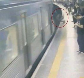 Βίντεο: Άντρας σπρώχνει άγνωστη γυναίκα στις γραμμές του τρένου την ώρα που ερχόταν ο συρμός  - Κυρίως Φωτογραφία - Gallery - Video