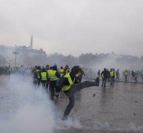 Η πόλη του φωτός σε κλίμα πολέμου : Κίτρινα γιλέκα με δακρυγόνα, φωτιές μαζικές συλλήψεις (φωτό) - Κυρίως Φωτογραφία - Gallery - Video