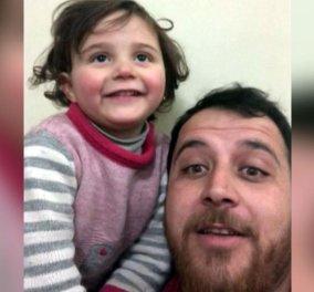 Story of the day: Όταν η φρίκη μετατρέπεται σε παιχνίδι- Πατέρας στη Συρία για να προστατεύσει την κόρη του της μαθαίνει να γελά όταν πέφτουν οι βόμβες (βίντεο) - Κυρίως Φωτογραφία - Gallery - Video