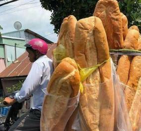 Αυτές οι φρατζόλες είναι γίγαντες: Ο Βιετναμέζος φούρναρης που προσελκύει το παγκόσμιο ενδιαφέρον με τα τεράστια ψωμιά του (φωτό) - Κυρίως Φωτογραφία - Gallery - Video