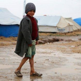 16/12/2014 - To παιδικό χαμόγελο μέσα στα χαλάσματα μιας ζωής πολλών ανθρώπων μιας ολόκληρης χώρας! Photograph: Reuters  - Κυρίως Φωτογραφία - Gallery - Video