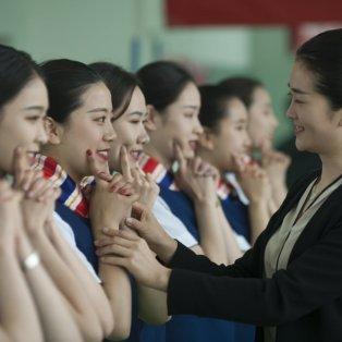 Mάθετε να χαμογελάτε όπως οι Κινεζούλες της φωτογραφίας - Getty Images - Κυρίως Φωτογραφία - Gallery - Video